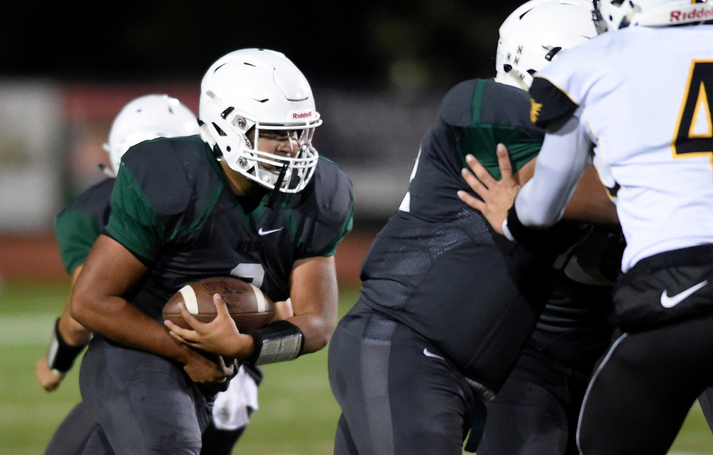 . LONGMONT, CO - OCTOBER 4, 2018: Niwot High School\'s Eric Ruiz runs the ball during a game against Thompson Valley on Thursday at Longmont High School. More photos: BoCoPreps.com (Photo by Jeremy Papasso/Staff Photographer)