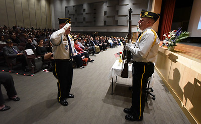 Members of the Brown and Lynch American legion Post 9 Honor Guard, stand guard along side the Empty Table. Phillipsburg area veterans Sunday, Nov. 11, 2018  were honored during the 21st annual William L. Nixon tribute. Hundreds attended the event at Phillipsburg High School in Lopatcong Township, in which the U.S. Department of Veterans Affairs has honored as a regional site for the observance of the commemoration.
