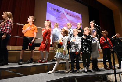 Lopatcong Township Elementary School Students recite the Pledge of Allegiance. Phillipsburg area veterans Sunday, Nov. 11, 2018  were honored during the 21st annual William L. Nixon tribute. Hundreds attended the event at Phillipsburg High School in Lopatcong Township, in which the U.S. Department of Veterans Affairs has honored as a regional site for the observance of the commemoration.