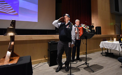 Coast Guard Veteran, John Bronoco salutes as he sings the National Anthem  as Retired Air Force Col. Jim Sikra plays the accordion.  Phillipsburg area veterans Sunday, Nov. 11, 2018  were honored during the 21st annual William L. Nixon tribute. Hundreds attended the event at Phillipsburg High School in Lopatcong Township, in which the U.S. Department of Veterans Affairs has honored as a regional site for the observance of the commemoration.