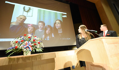 Phillipsburg High School Guidance Counselor, Brandon Beahn, along with Phillipsburg High School student, Lexie Crosson, Skypes a live video conference with Lexie's sister, Stephanie (Crosson) Keiper and her family, Army Staff Sgt. Ricky Keiper, and their children, Ethan, Adrian and Lillian. Stephanie graduated Phillipsburg High School and Ricky graduated Wilson High School. They are stationed at Ft. Irwin, California. Phillipsburg area veterans Sunday, Nov. 11, 2018  were honored during the 21st annual William L. Nixon tribute. Hundreds attended the event at Phillipsburg High School in Lopatcong Township, in which the U.S. Department of Veterans Affairs has honored as a regional site for the observance of the commemoration.