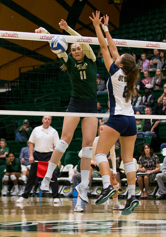 . Colorado State middle blocker Paulina Hougaard-Jensen gets a block against UC Davis Saturday afternoon Nov., 25, 2017, at Moby Arena in Fort Collins. The Rams beat the Aggies, 3-1. (Michael Brian/For the Reporter-Herald)