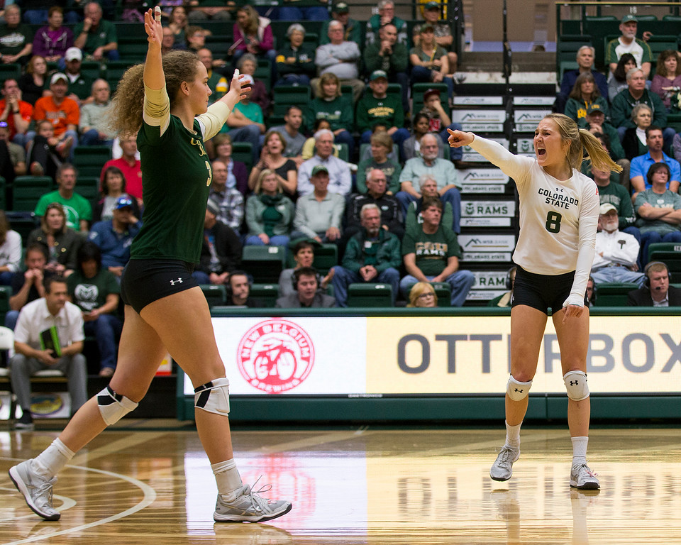 . Colorado State libero Amanda Young (8) celebrates teammate Olivia Nicholson\'s point against UC Davis Saturday afternoon Nov., 25, 2017, at Moby Arena in Fort Collins. The Rams beat the Aggies, 3-1. (Michael Brian/For the Reporter-Herald)