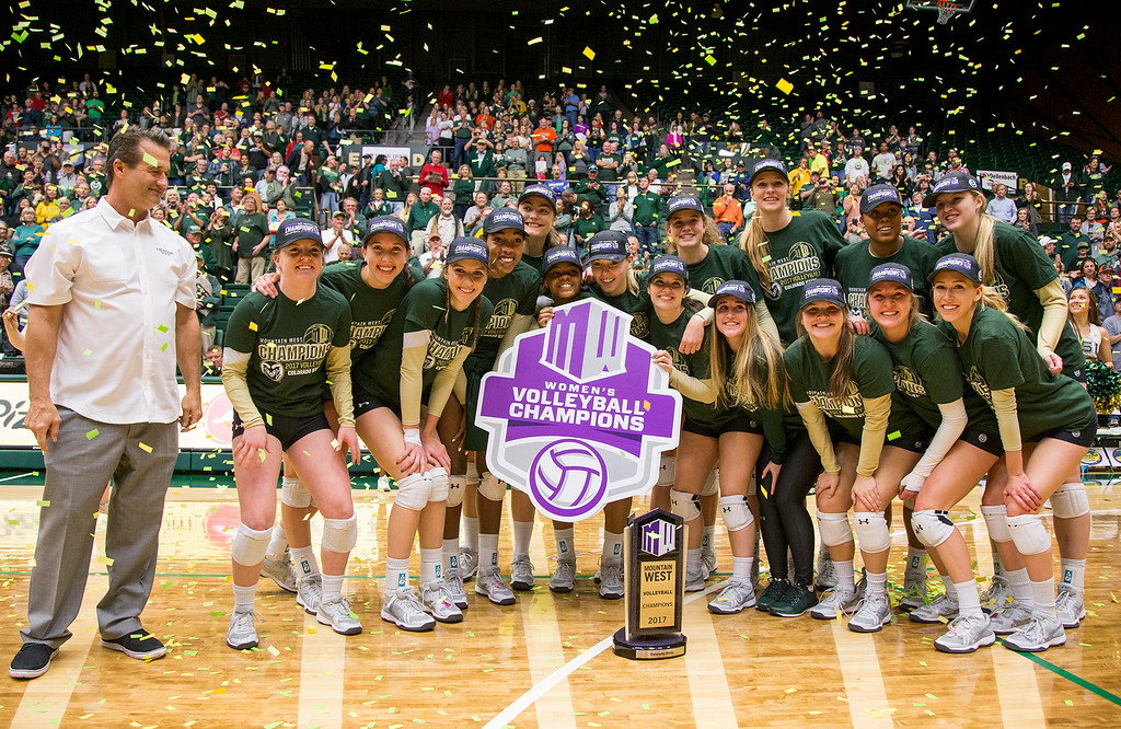 . Colorado State head coach Tom Hilbert, left, and the Rams volleyball team celebrate their Mountain West Conference Championship after finishing their season with a win against UC Davis Saturday afternoon Nov., 25, 2017, at Moby Arena in Fort Collins. (Michael Brian/For the Reporter-Herald)