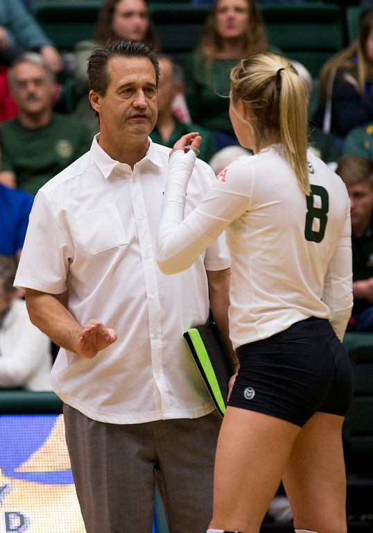 . Colorado State head coach Tom Hilbert gives instructions to libero Amanda Young (8) during a timeout against UC Davis Saturday afternoon Nov., 25, 2017, at Moby Arena in Fort Collins. The Rams beat the Aggies, 3-1. (Michael Brian/For the Reporter-Herald)