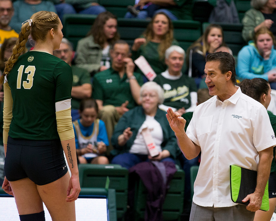 . Colorado State coach Tom Hilbert, right, talks to Kristie Hillyer (13) during a timeout against UC Davis Saturday afternoon Nov., 25, 2017, at Moby Arena in Fort Collins. The Rams beat the Aggies, 3-1. (Michael Brian/For the Reporter-Herald)