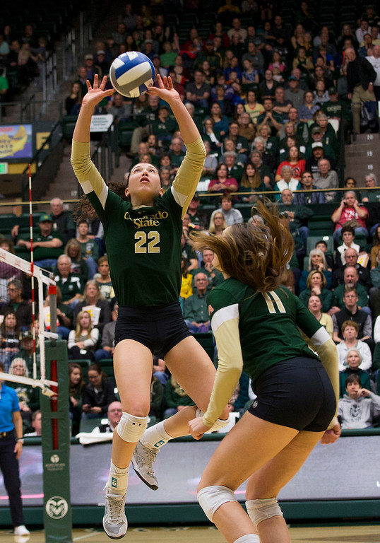 . Colorado State setter Katie Oleksak (22) set the ball for teammate Paulina Hougaard-Jensen (11) against UC Davis Saturday afternoon Nov., 25, 2017, at Moby Arena in Fort Collins. The Rams beat the Aggies, 3-1. (Michael Brian/For the Reporter-Herald)