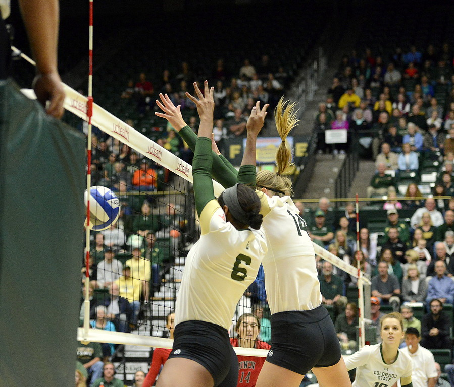 Colorado State's Jasmine Hanna (6) and Alexandra Poletto combine for a block during Saturday's match against UNLV at Moby Arena.