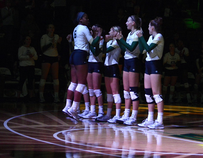 Colorado State's Jasmine Hanna high-fives teammates as she's intruduced prior to Saturday's match with UNLV at Moby Arena.