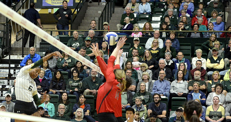 Colorado State's Jasmine Hanna beats the block of UNLV for one of her team-leading 12 kills as the No. 23 Rams swept the Rebels on Saturday at Moby Arena.