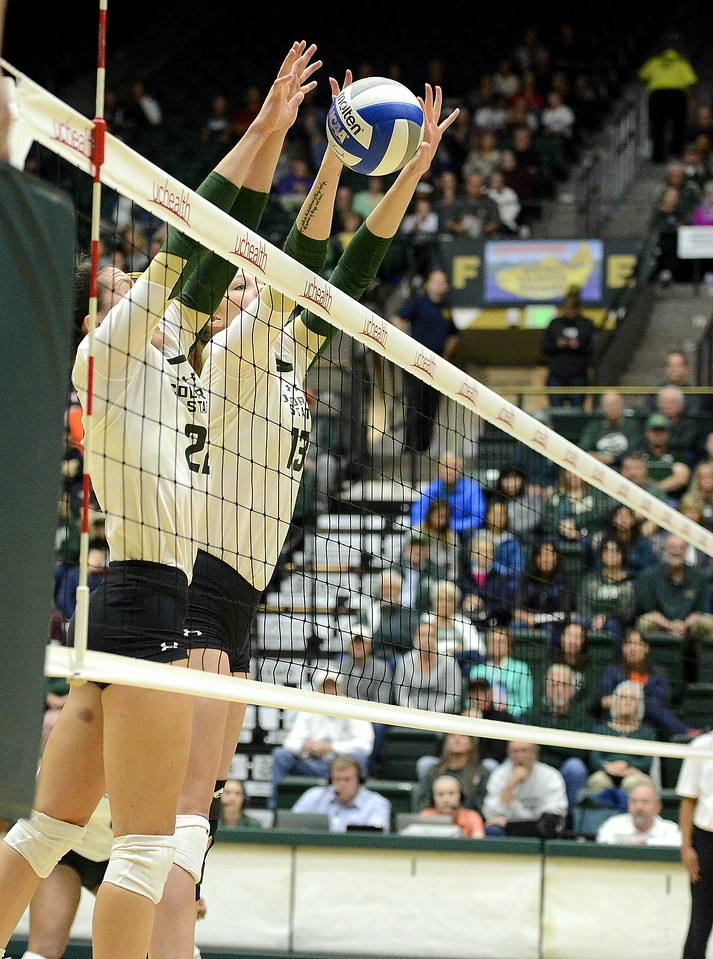Colorado State's Katie Oleksak (22) and Kirstie Hillyer rise up for a block against UNLV during Saturday's match at Moby Arena.