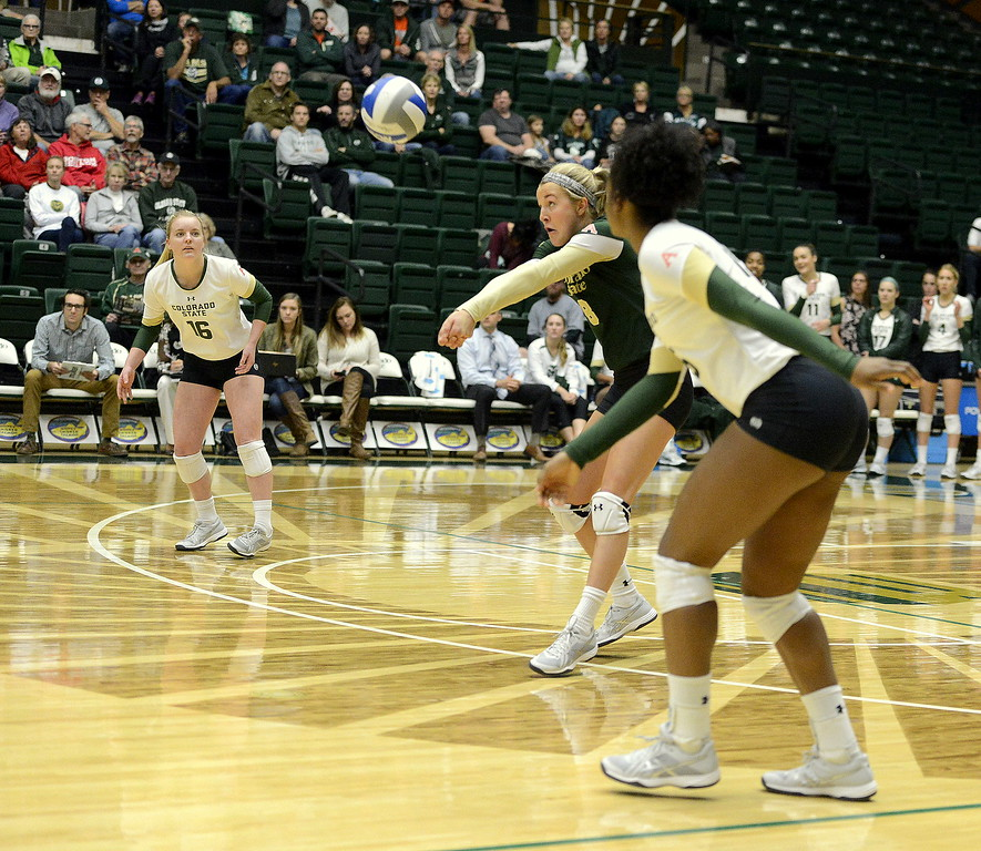 Colorado State libero Amanda Young delivers a pass on serve receive as teammates Maddi Foutz (16) and Breana Runnels look on during Saturday's match with UNLV at Moby Arena.