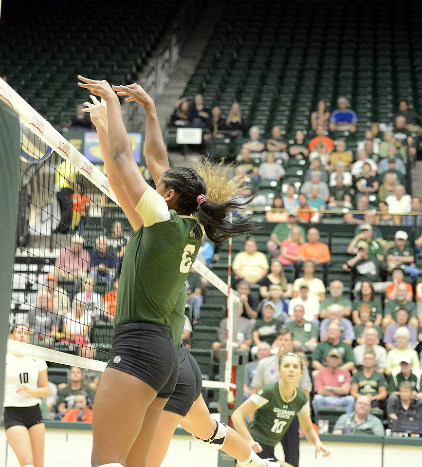 Colorado State's Jasmine Hanna (front) and Olivia Nicholson team up for a block during Friday's match with Ball State at Moby Arena in Fort  Collins.