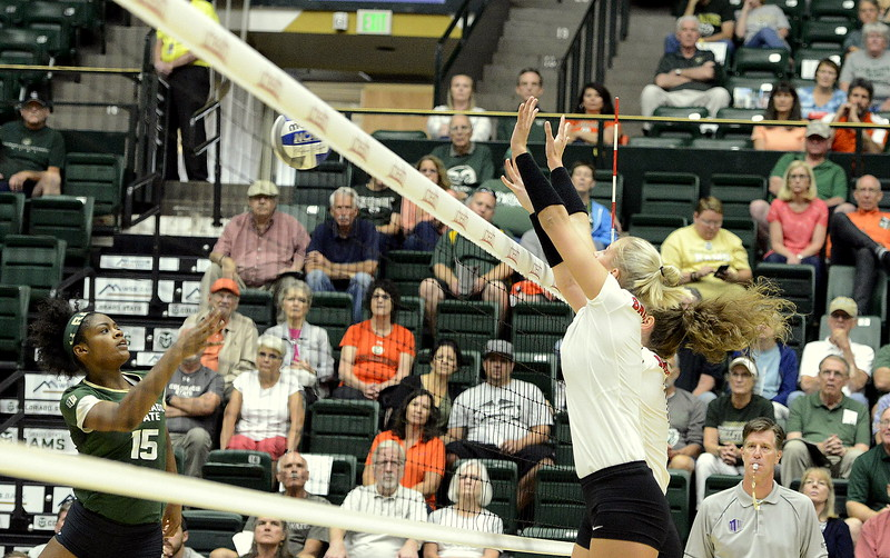 Colorado State's Breana Runnels tries to push a shot past the Ball State block during their match Friday at Moby Arena in Fort Collins.