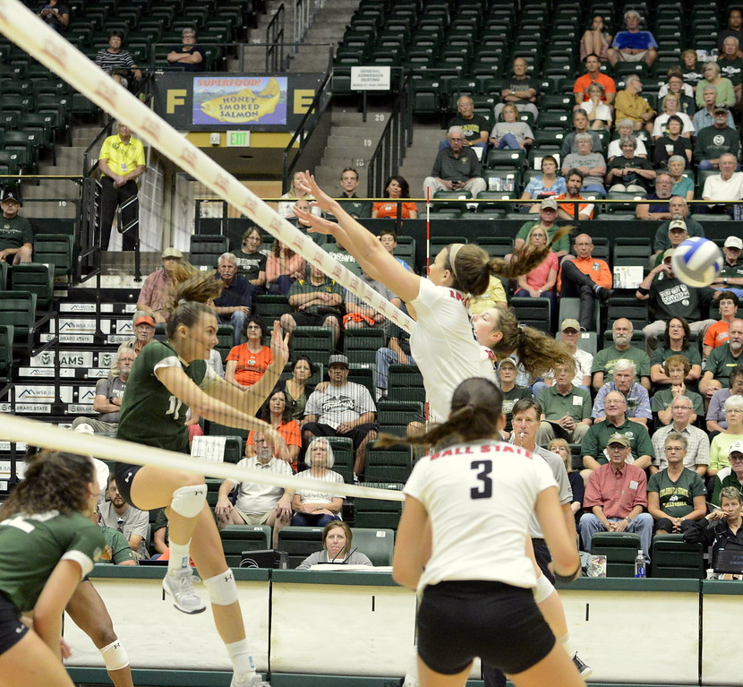 Colorado State middle blocker Paulina Hougaard-Jensen finishes her swing as she blasts a kill past the Ball State defense Friday in their match at Moby Arena in Fort Collins.