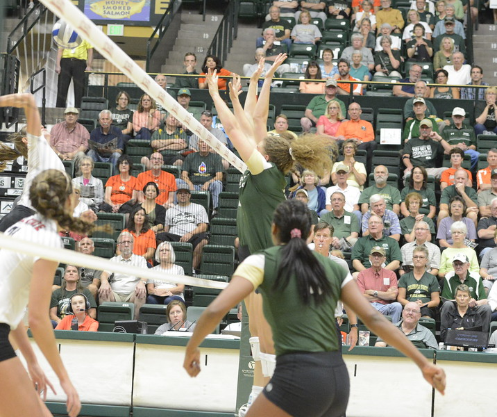 Colorado State's Jasmine Hanna looks on as teammates Olivia Nicholson and Sanja Cizmic rise up for a block during Friday's match with Ball State at Moby Arena in Fort Collins.
