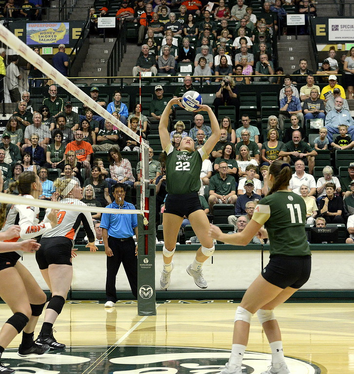 . Colorado State setter Katie Oleksak jumps to deliver a set during the No. 25 Rams\' sweep Sunday of Idaho State at Moby Arena in Fort Collins.