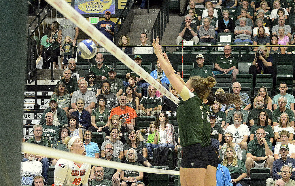 . Olivia Nicholson (front) and Katie Oleksak team up for a block during the No. 25 Rams\' Sunday sweep of Idaho State at Moby Arena in Fort Collins.
