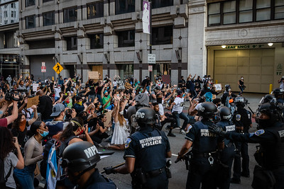 Protesters kneel as they raise their hands in front of police in Washington, DC on May 31, 2020.