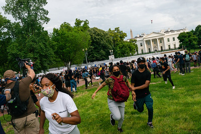 Somone mistakes a projectile as tear gas, causing protesters to run outside the White House on May 29, 2020.