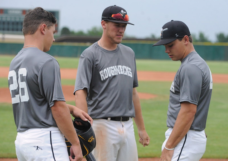 NoCo Roughneck teammates, from left, Matt Berg, Dylan Norsen and Mike Berg chat before their Boulder NIT game Wednesday at Fairview High School.