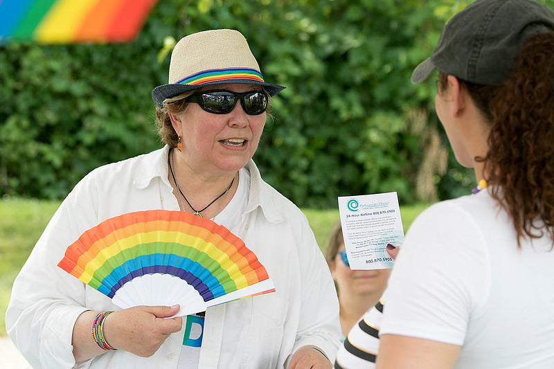 The first North Worcester Country (NoWoCo) Pride Festival was held on Saturday, July 20, 2019 at Riverfront Park in Fitchburg. Kim Dawkins of the Worcester's Pathway for Change, local rape crisis center, talks to some of the people that came to the festival at her table at the event. SENTINEL & ENTERPRISE/JOHN LOVE