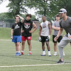 Football players listen to some tips from Noah Gray during his Football Clinic held at Doyle Field in Leominster on Friday June, 25, 2021. SENTINEL & ENTERPRISE/JOHN LOVE