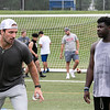 Noah Gray gives some tips to Leominster senior Steff Rosemond at his Football Clinic held at Doyle Field in Leominster on Friday June, 25, 2021. SENTINEL & ENTERPRISE/JOHN LOVE