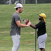 Noah Gray gives some tips to Jeremy Ndegua, 12, from Tyngsboro at his Football Clinic held at Doyle Field in Leominster on Friday June, 25, 2021. SENTINEL & ENTERPRISE/JOHN LOVE
