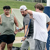 Noah Gray gives some tips to  players on shedding hands during a defensive drill at his Football Clinic held at Doyle Field in Leominster on Friday June, 25, 2021. SENTINEL & ENTERPRISE/JOHN LOVE