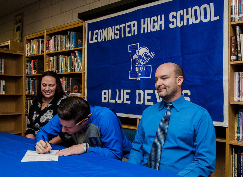 Noah Gray made his collegiate choice official at Leominster High School by signing his national letter of intent to play Division 1 football at Duke University on Wednesday, February 1, 2017. Gray signs his letter surrounded by parents Meagan and Jason Gray. SENTINEL & ENTERPRISE / Ashley Green