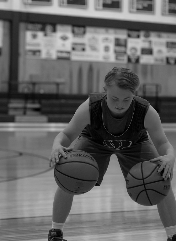 . Noah Olson, a freshman at Estes Park High School, practices dribbling two balls at once.