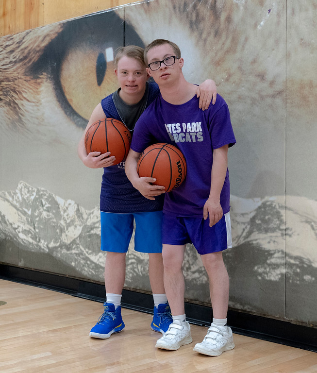 . Noah Olson, left and Mark Query take a break during basketball practice to pose for a photo. The two boys have down syndrome, with Mark also living with autism. The two boys have formed an unbreakable bond this past year, and the community has rallied around them every step of the way.