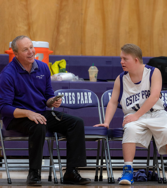 Estes Park High School Principal Chuck Scott laughs at a joke cracked by Noah Olson.