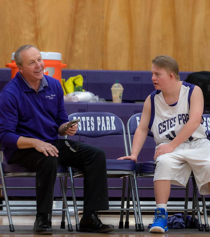 . Estes Park High School Principal Chuck Scott laughs at a joke cracked by Noah Olson.