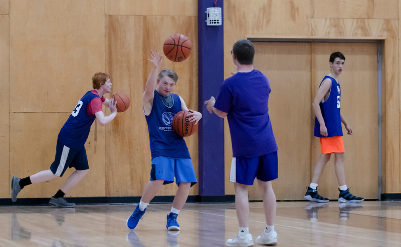 During an after school practice, Noah Olson and Mark Query practice their passing to one another. Though the two boys have Down syndrome, that doesn't hold them back from getting just as involved with the school as their peers do.