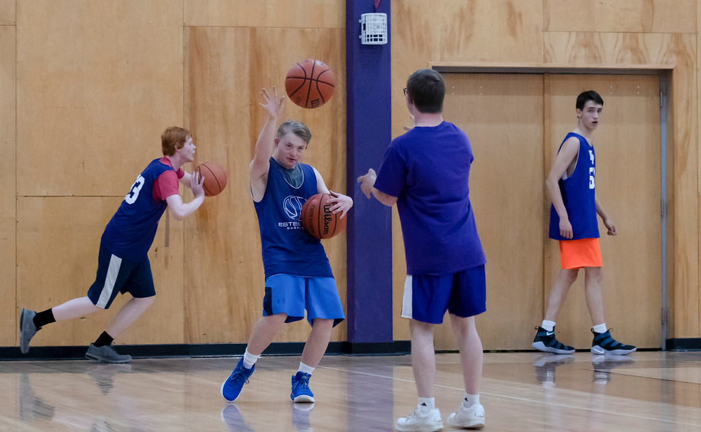 . During an after school practice, Noah Olson and Mark Query practice their passing to one another. Though the two boys have Down syndrome, that doesn�t hold them back from getting just as involved with the school as their peers do.