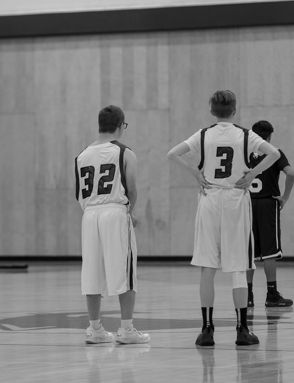 . Mark Query and his teammate Brysen Long watch as a Valley High School player takes a free throw.