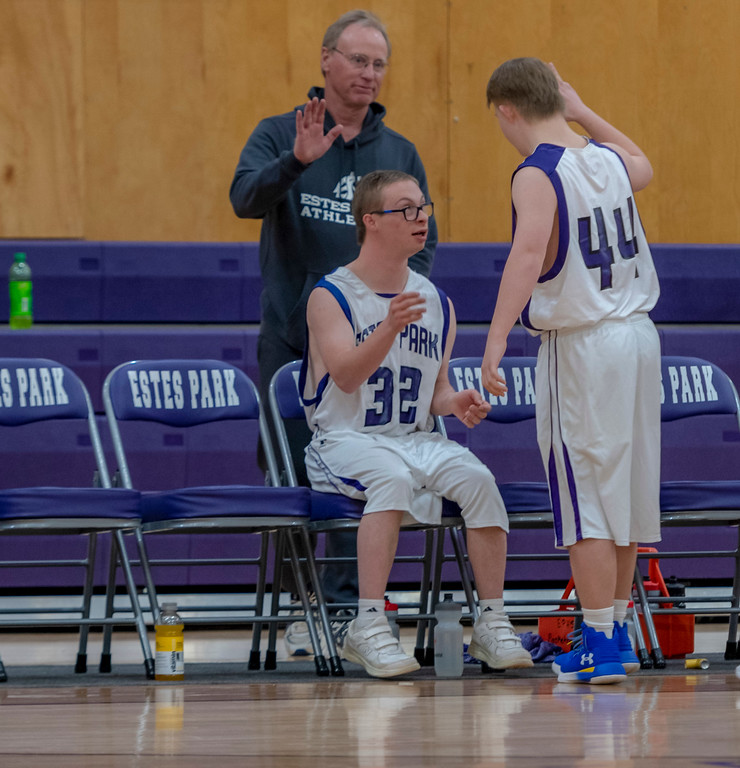 . Mark Query gives his best friend Noah a high-five after making two baskets in a row.