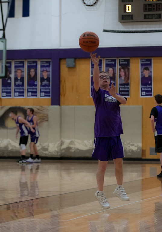 . Mark Query fires a shot during after school basketball practice on Feb. 5. Query lives with both Down syndrom and autism.