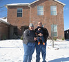 Our first family snow picture... with the camera gently nuzzled in the snow on top of the Mustang
