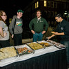 Nicole Pelzer, Andrew Pelzer, Chris Fiske and Tom Fisette serve food from Campus Pizza during 'Noche Caliente' at Fitchburg State on Wednesday evening. The night was to promote local Fitchburg restaurants and brings campus clubs and organizations together. SENTINEL & ENTERPRISE / Ashley Green