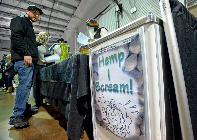 Brady Price of Loveland, left, talk with Das Ellis, right, founder of Boulder based Hemp I Scream! Friday, April 7, 2018, during the Noco Hemp Expo at the Ranch in Loveland. Price is a CBD hemp farmer in Loveland.  (Photo by Jenny Sparks/Loveland Reporter-Herald)