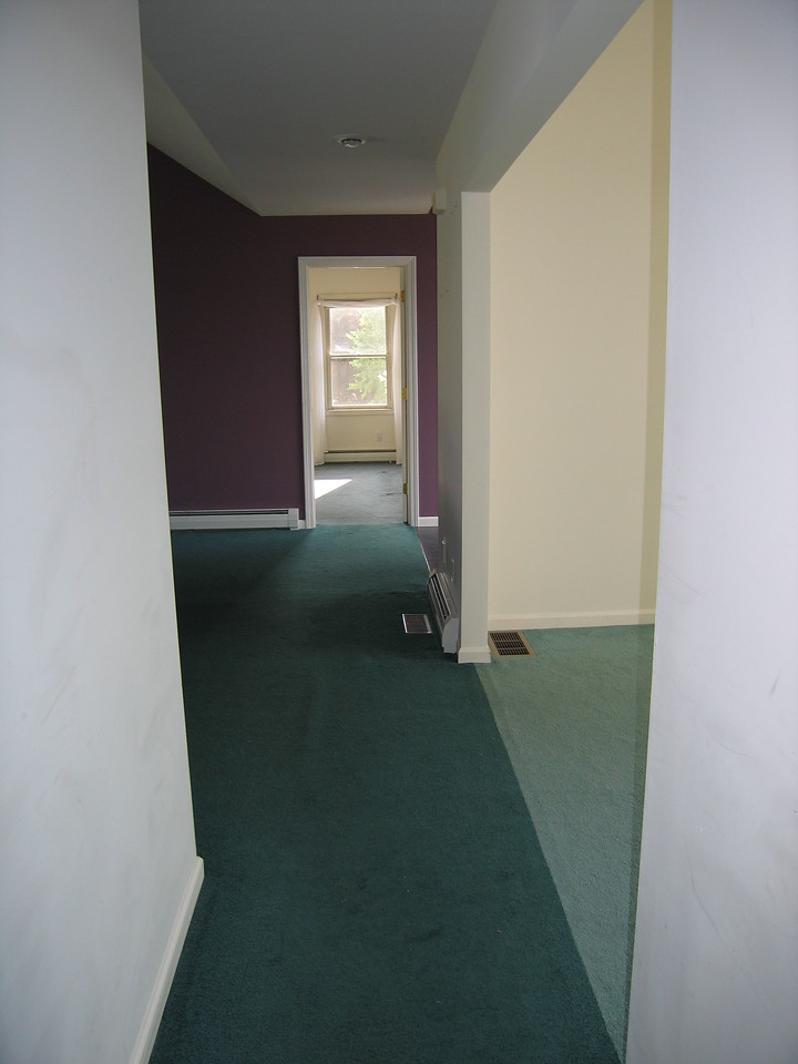 32 Hallway with Great Room on Left and Alcove on Right