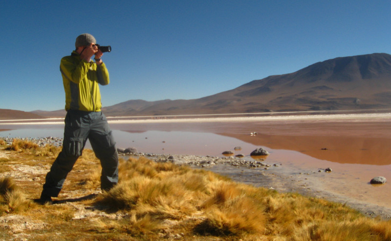 "A travel photo featuring Nomadic Samuel Jeffery photographing the impressive Uyuni Salt Flats, Bolivia.  Travel photo from the Nomadic Samuel's adventure gallery. <a href=""http://nomadicsamuel.com"">http://nomadicsamuel.com</a>"