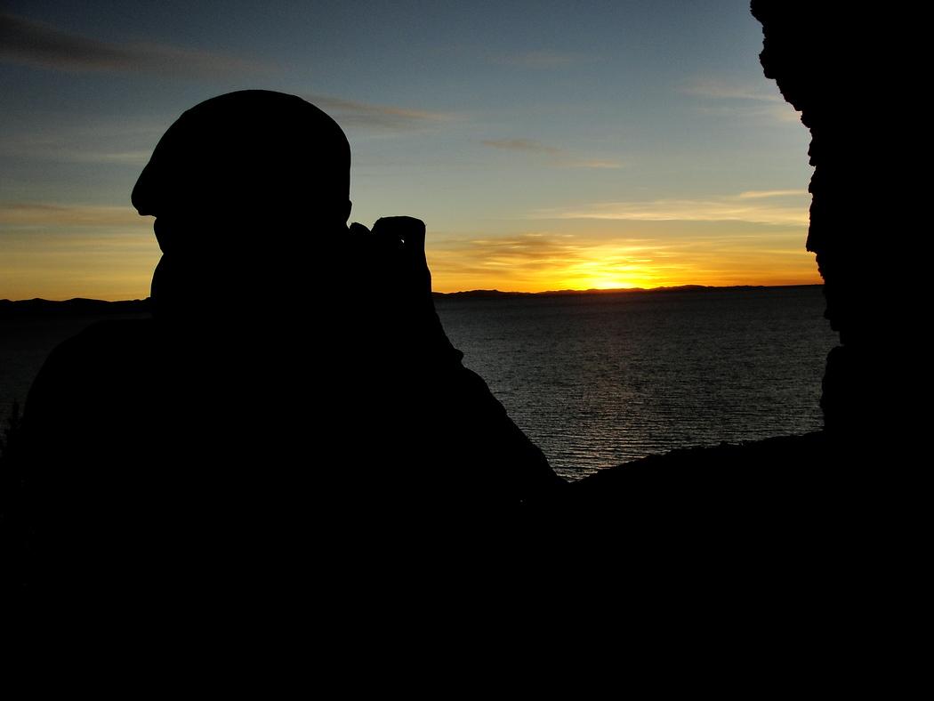 http://nomadicsamuel.com : Daily travel photo of Nomadic Samuel rendered as a silhouette during a gorgeous sunset in Copacabana - Lake Titicaca, Bolivia.