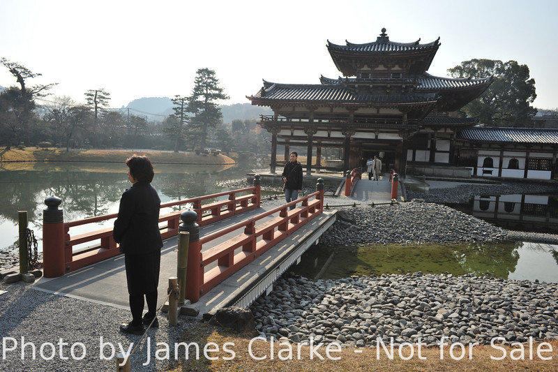 At the Bridge to Byodoin.<br /> This the bridge that for an extra fee gains you access to the temple building where your not even allowed to take photos, let alone non commercial photos!<br /> It is a condition of entry of Byodoin Temple that any photos taken there are not used for commercial purposes. The funny thing is: an image of this temple is on the 10 yen coin, and that's being used for commercial purposes every day.