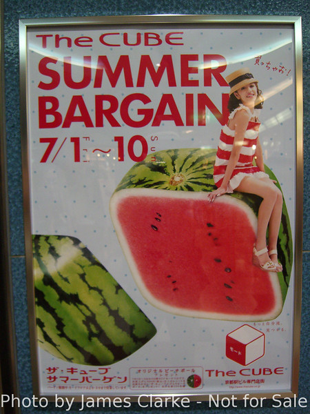 "A Poster Advertising Summer Bargains at ""The Cube"".<br /> A shopping arcade under Kyoto Station. Tis the season!"
