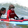 Grant Kobayashi handles precious cargo - 5 year old Hunter Pochop, born with Spina Bifida