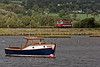 """Spencer Johns"" moored on the River Axe Estuary, while Tram No. 14 passes in the background. 6th October 2015."